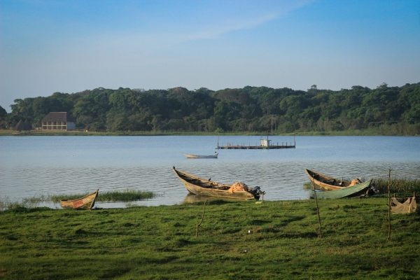 Lake Victoria in Uganda and an empty wooden poor fisherman boat.